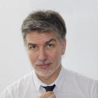 Dr. Andrés Román